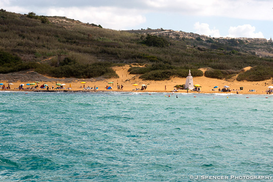 The orange sand beach at Gozo.  Too much current to swim to, unfortunately.