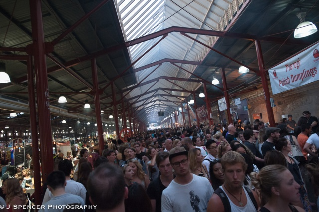 Crowded Victoria Market at dinnertime in summer